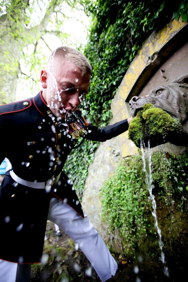 Cpl. Brian Conley of 5th Marine Regiment, 1st Marine Division drinks from the Devil Dog Fountain in the town of Belleau, France, May 26. After participating in the Memorial Day ceremony at the Belleau cemetery the Marines of 5th Marine Reg. walked to the town of Belleau to spend time with the locals and French marines to strengthen French-American relationships while memorializing losses in the battle of Belleau Wood. (Official Marine Corps photo by: Cpl. Daniel A. Wulz)