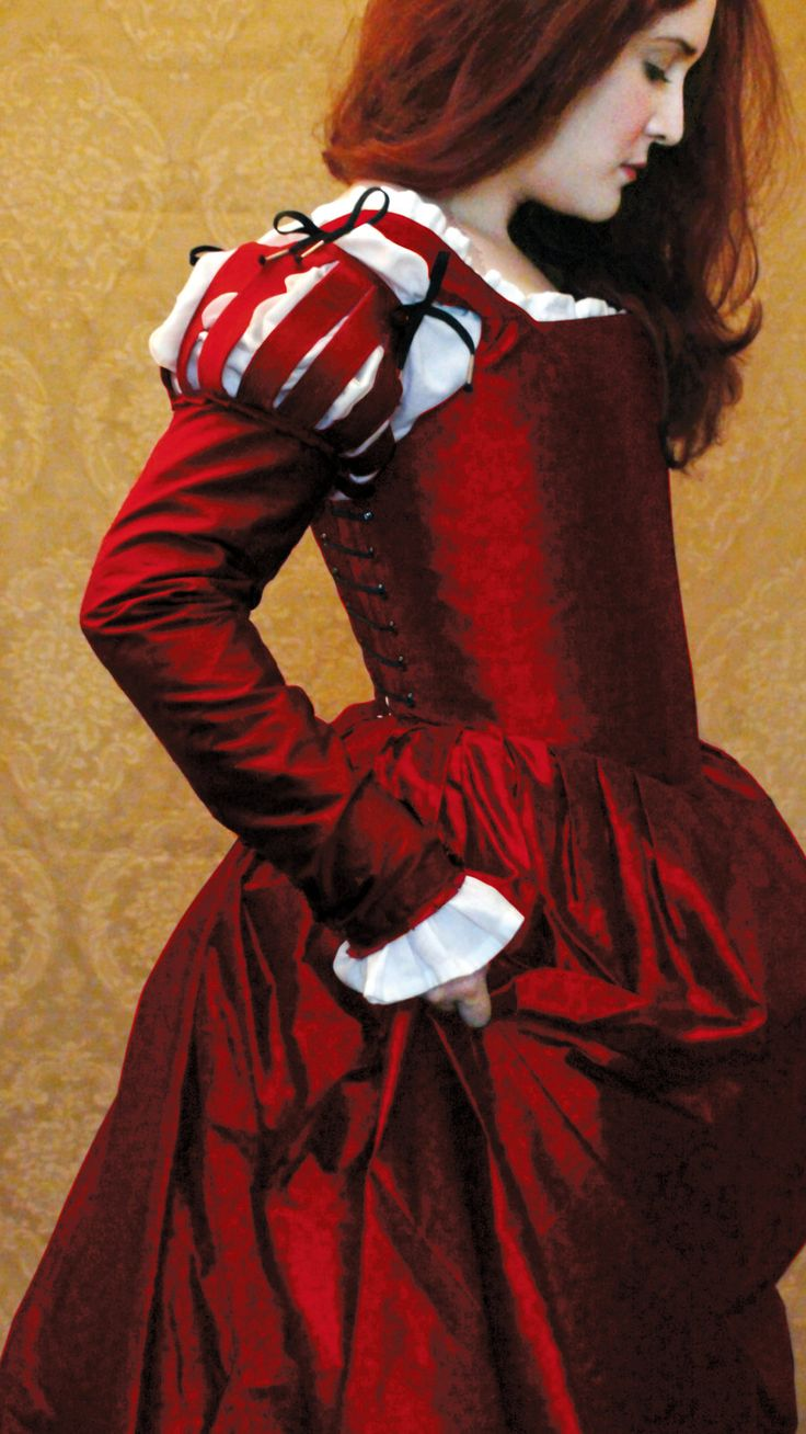 Corset gown of cherry red silk shantung, shoulder paned sleeves by Decosa Design LLC.