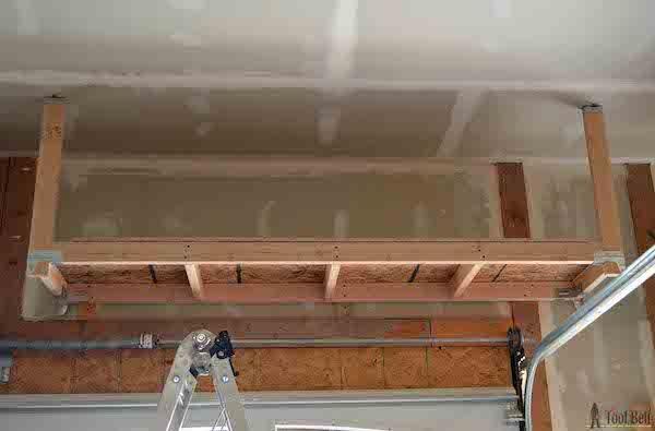 Diy How To Build Suspended Garage Storage Shelves In 2020 Garage Storage Shelves Diy Overhead Garage Storage Garage Ceiling Storage