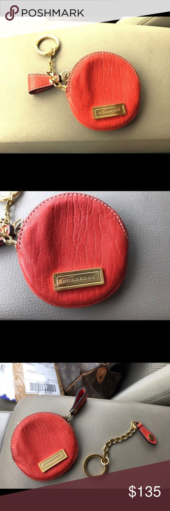 Authentic Burberry round change purse / keychain Authentic Burberry round coin purse in burnt orange - lambskin with gold hardware. Keychain is detachable so this can be used as a coin purse, a key chain a bag charm or just a purse organizer for headphones and such. Serial number pics included. Used but still plenty of life - no significant damage or wear - see photos for current condition. Message for further details photos or offers. Burberry Accessories Key & Card Holders