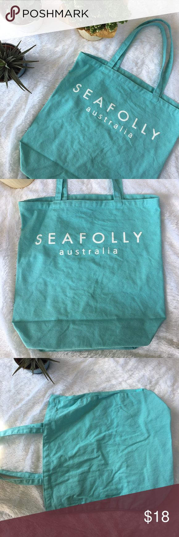 "Light Blue Canvas Tote Bag Cute blue and white tote bag! Front reads ""SEAFOLLY Australia"". Clean, no holes or stains. Only used on vacation once. Great for summer adventures, a book bag, or grocery trips! Bags Totes"