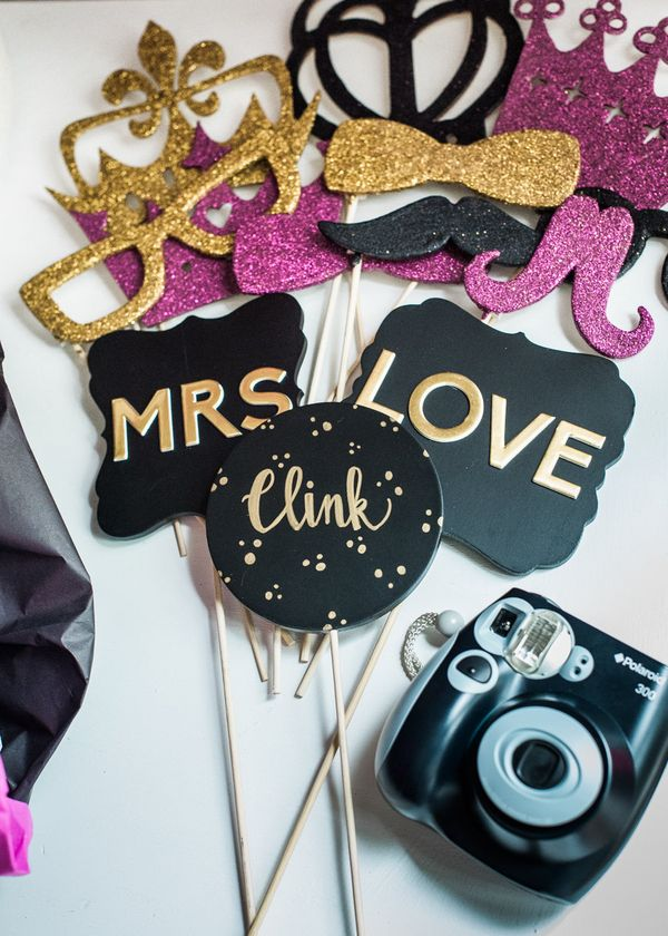 It's easy to create your own with DIY props, a photo backdrop, and an instant camera. | Photo Booth Props and Camera | Kate Spade Bridal Shower | B. Jones Photography
