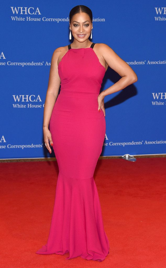 La La Anthony from White House Correspondents' Dinner 2016: Star Sightings  The actress popped in a bright pink mermaid curve-hugging gown.