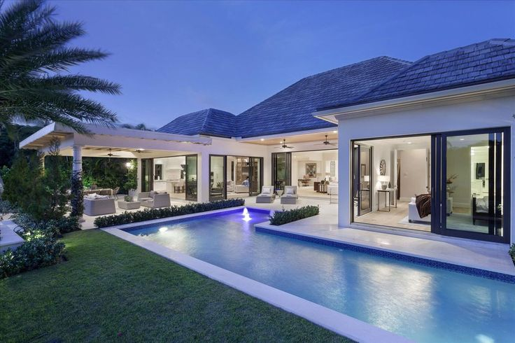 Contemporary Swimming Pool with exterior stone floors ...