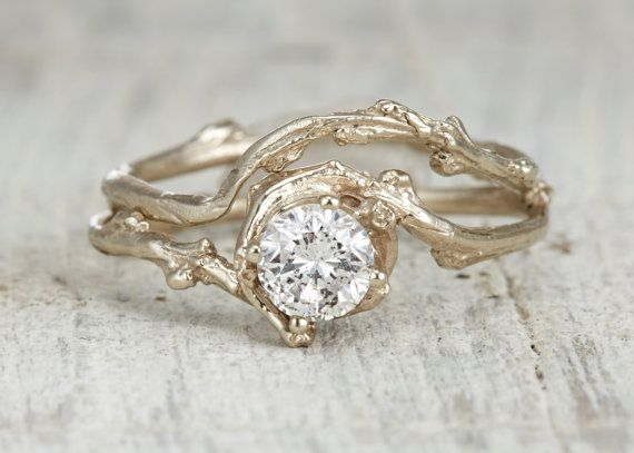 A delicate solid 14kt recycled gold twig encircling a beautiful brilliant cut .40 carat white diamond. This is a truly unique engagement ring.