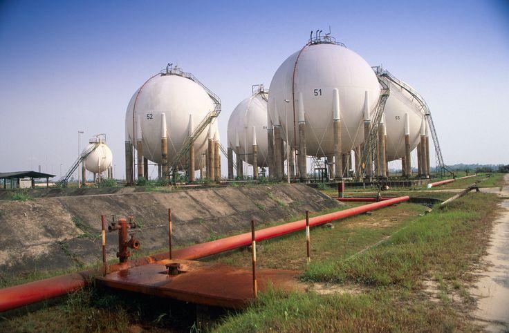 Spherical storage vessels and pipework with bund ditch in NNPC oil refinery in Warri Nig - #OilBook #Nigeria #Africa