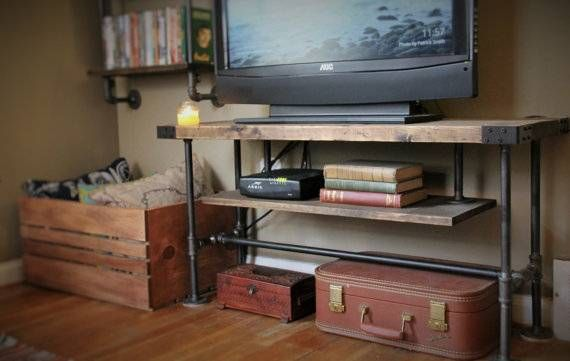 Class up your television with this beautiful Industrial-style TV console! Handmade from sturdy industrial pipe and hand-finished Pine. -Crafted from industrial-strength 1/2 metal pipe and select Pine