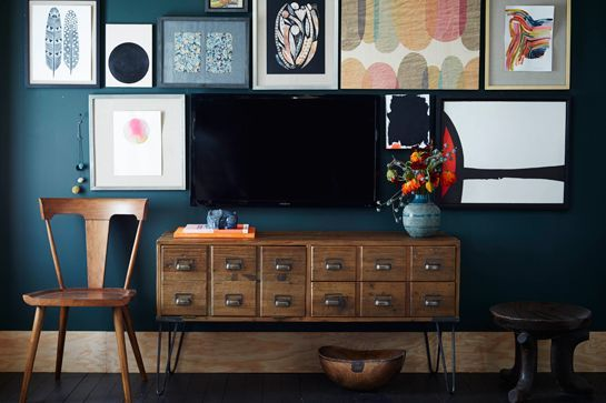 Style Your Place Like A Home Catalog — All The Tricks #refinery29  http://www.refinery29.com/2014/07/70895/west-elm-fall-2014-collection#slide-2  With a dark blue shade behind it, the TV blends seamlessly into the gallery wall.