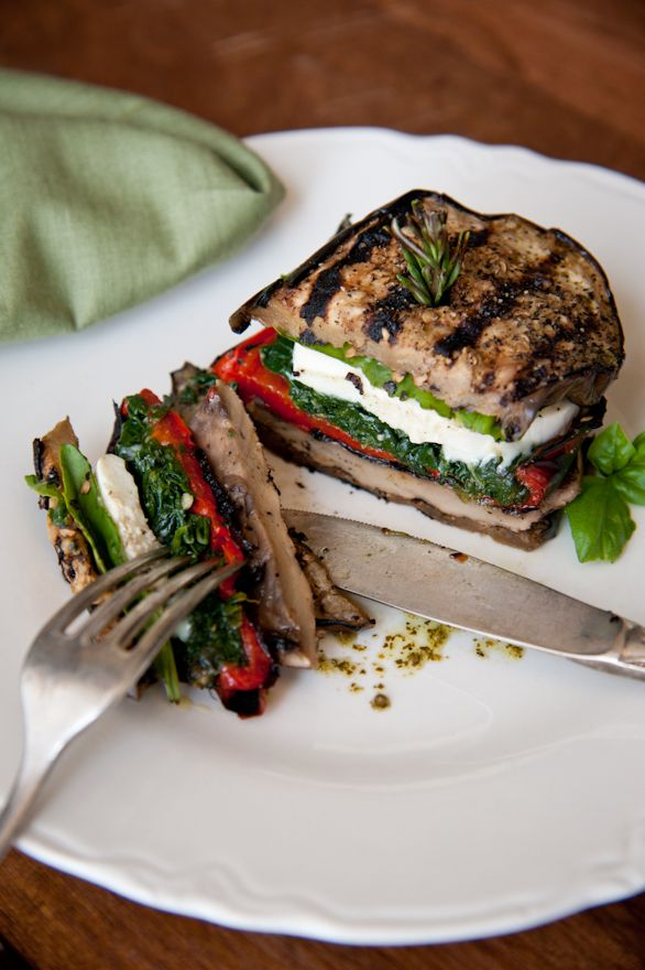 Grilled eggplant mozzarella stacks that include roasted red pepper, Portobello mushrooms, spinach, basil and drizzled with a bit of pesto olive oil