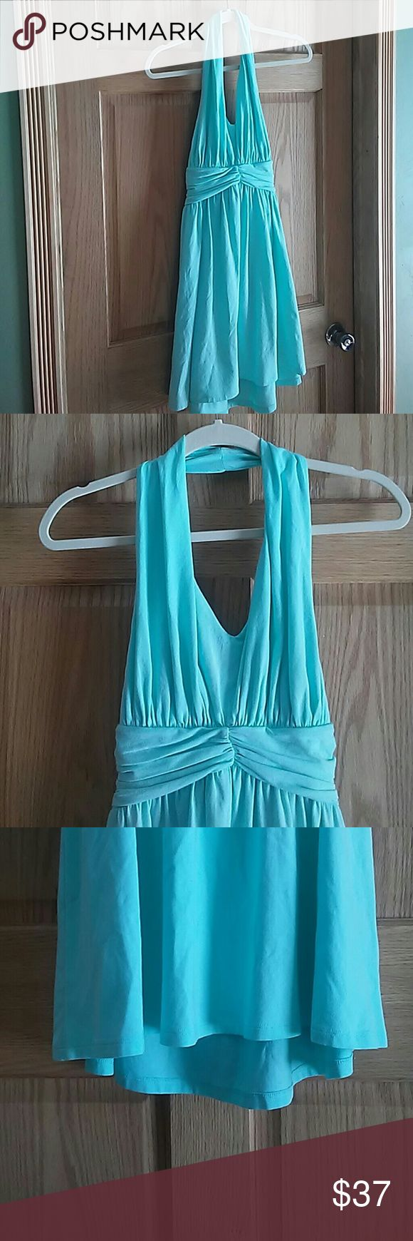 Express hater top mint color dress NWT Hard to get the color of this dress in a photo but its a beautiful mint color. The back of the dress is a little longer then the front. Great for a graduation dress! Express Dresses
