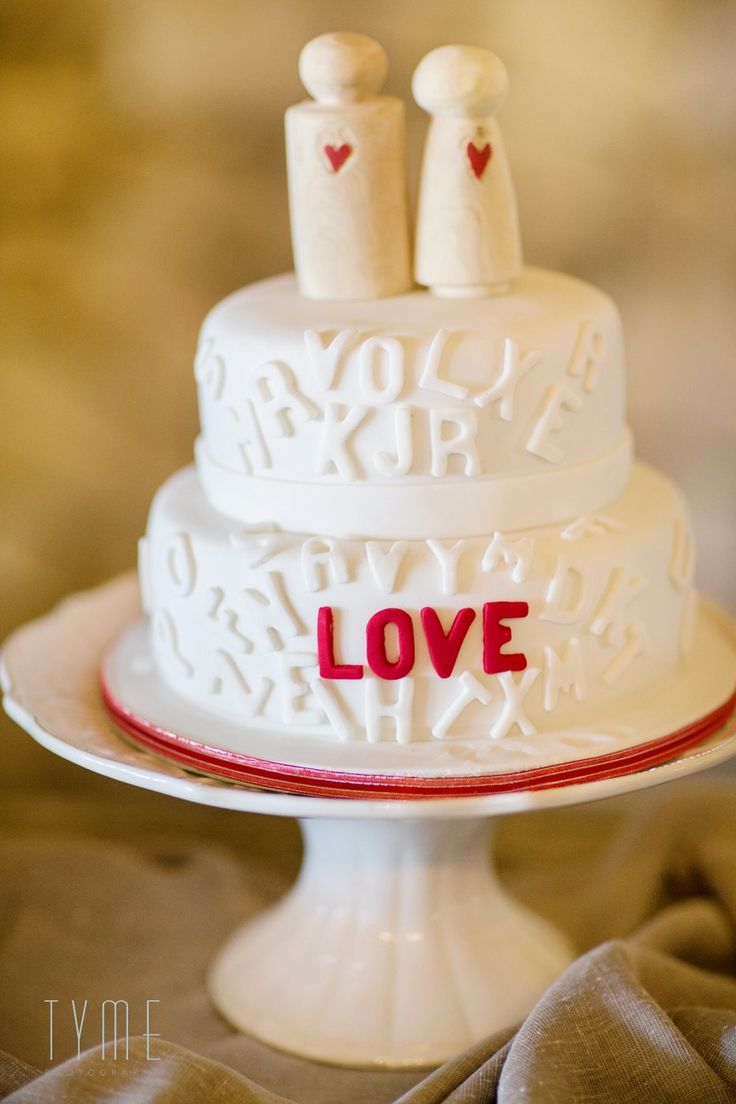 Unique red velvet wedding cake. LOVE letters. Creation Station Cakes and Cupcakes Tyme Photography