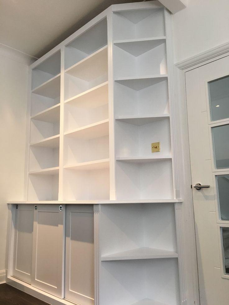 brilliant white living room unit with corner shelving in