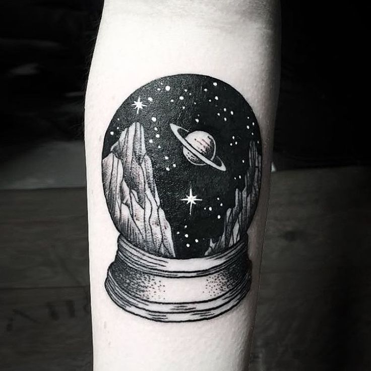 Globe on forearm.                                                                                                                                                                                 Mais
