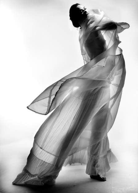 Image by Nick Knight. I like the organisation of this image because the material is being pressed onto the subject creating light structured shadows. The high contrast in the background is bringing out the shape of the subject creating boldness by hiding its identity. The black and white are blending together creating light and dark grey tones to add a mixture into the image.
