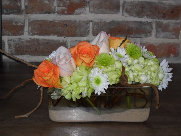 bridesmaid's bouquet flowers = green hydrangea + orange roses and yellow centered white gerbera