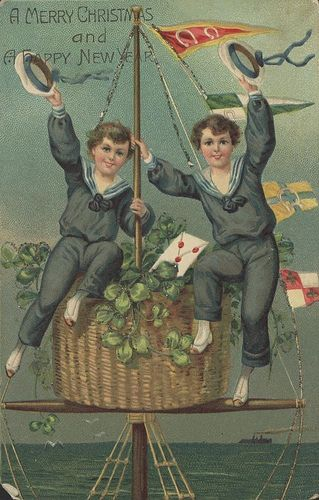 Christmas greeting card showing two boys in sailor suit waving from the crow's nest of a ship.