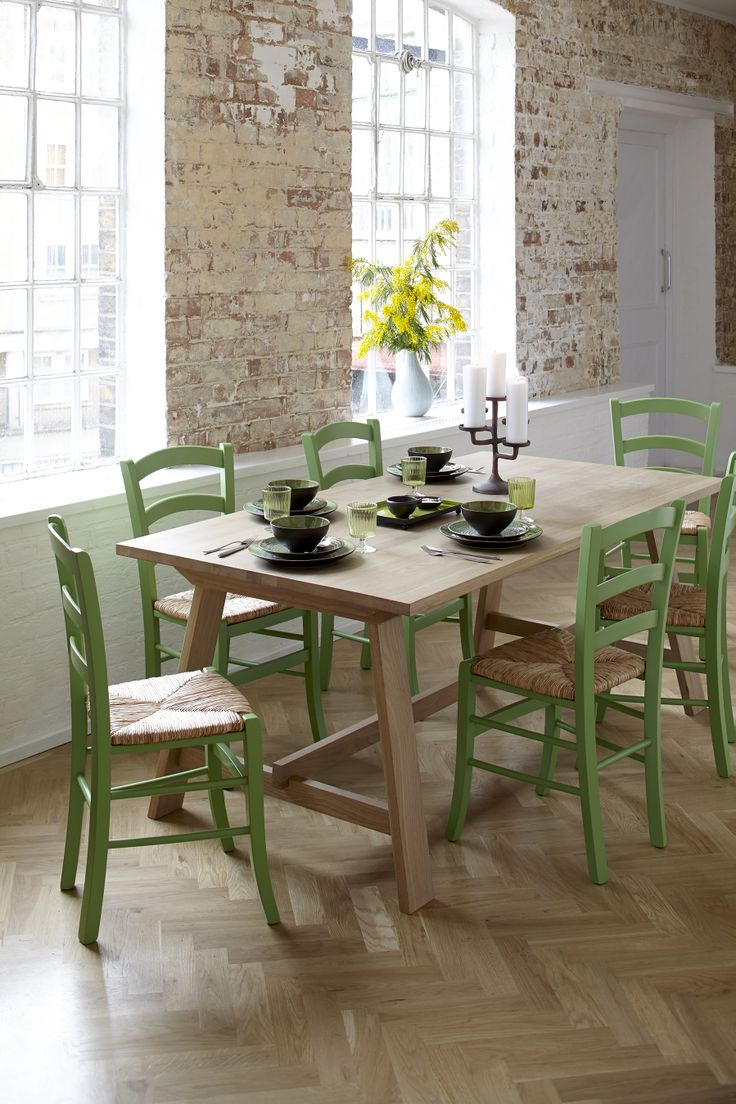 Rufus dining table with bright green Jak chairs, inspired by Van Gogh's chair.