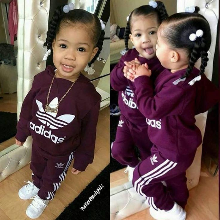 Precious little girl sportin' Adidas. (Looks like my daughter back in the day. Even the way I styled her hair & dressed her. Flashback. ~ Leasa)