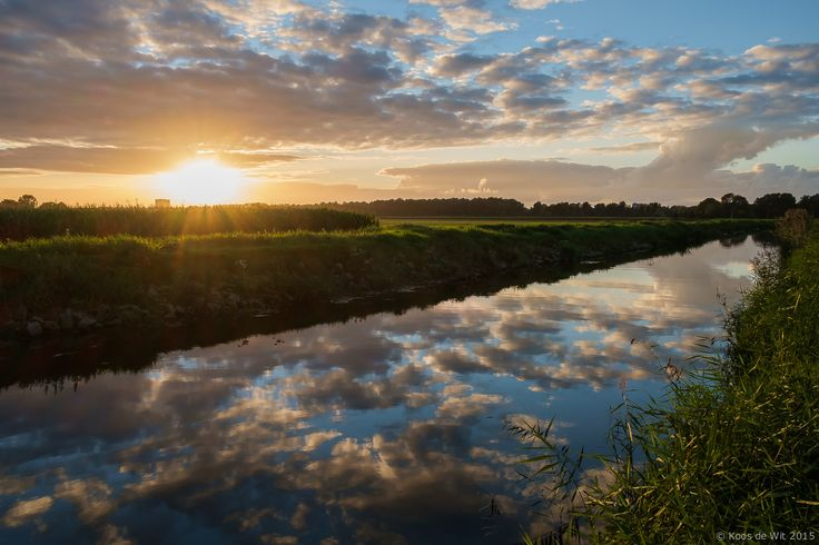 https://flic.kr/p/yRYqfX | Sunset at the Borgsloot, Groningen | On my way for a sunset session I drove by this spot and saw the sun, clouds and reflections. I stopped and quickly took a couple of shots... handheld, no tripod, no filters and this was the result... Love that X-E1 :-) Taken in Groningen, The Netherlands. Thanks to everyone who takes the time to comment and/or fave. © Koos de Wit All rights reserved. Please don't use this image without my permission.