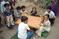 Children playing carrom in Yemen