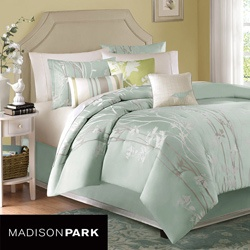 This Athena comforter set from Madison Park features a contemporary look with a modern edge. This 7-piece comforter set showcases a grey and white floral design against a soft blue background.