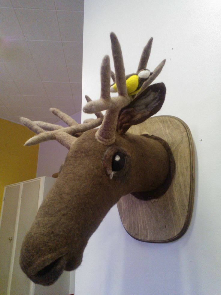 A felted moose with a bird.