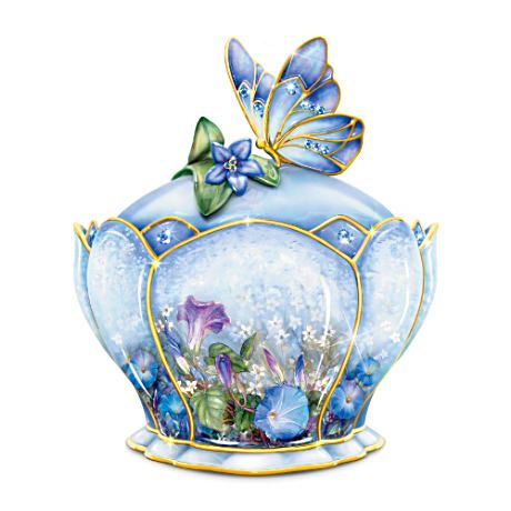 "Limited-edition Heirloom Porcelain® Lena Liu music box has sapphire-colored Swarovski crystals and butterfly lid. Plays ""On the Wings of Love."""