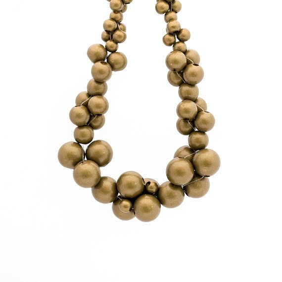 MoleCOOLs Gold wooden necklace