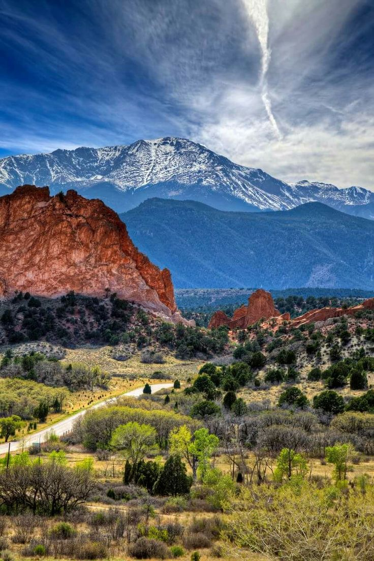 Pikes Peak towering over Garden of the Gods in Colorado Springs, Colorado.