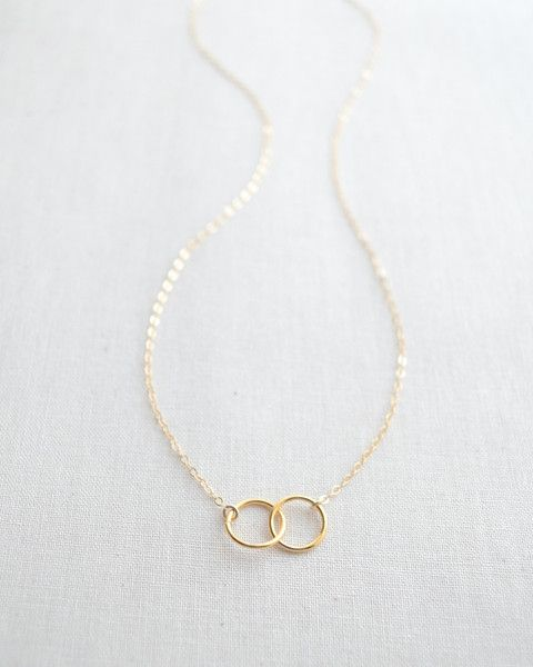 Double Circle Necklace by Olive Yew. Two interlocking gold circles create a simple and classic look. Available only in gold.