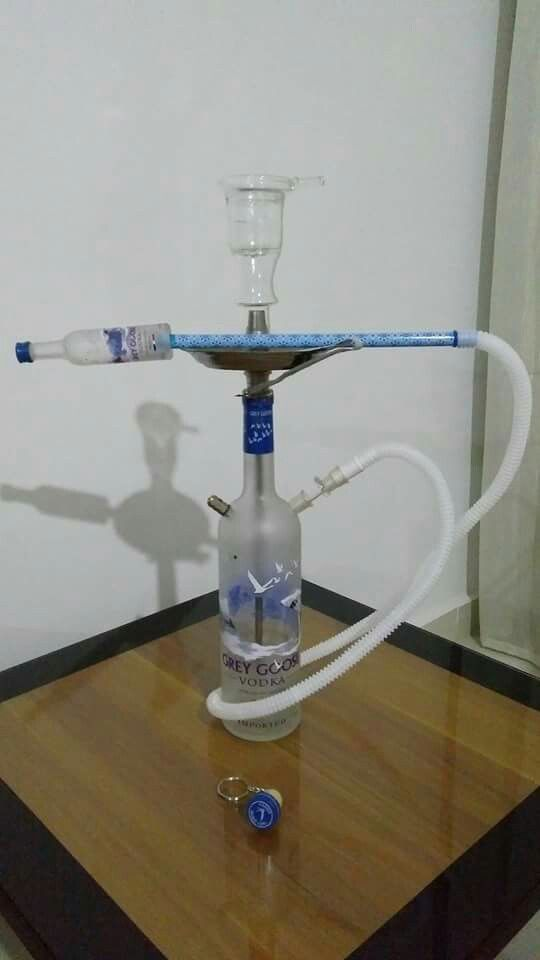 Handmade Shisha made of Grey goose vodka bottle with small grey goose bottle in the hose Price : 60 $