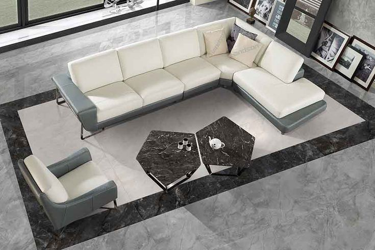 Beautiful marble effect large format and ultra thin porcelain tile used on the floor of this elegant living room. #marble #porcelain #living #room #tiles
