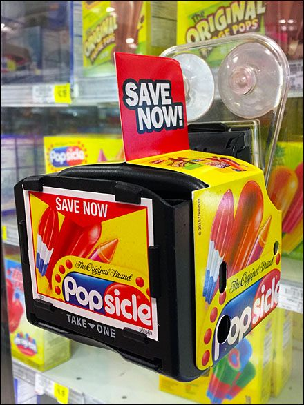 """An """"eyebrow"""" to the Popsicle® name reminds you this Cooler Door couponing supports the """"Original Brand"""" and no other. If you want the classic flavored frozen ice pop taste, then you simply must buy..."""