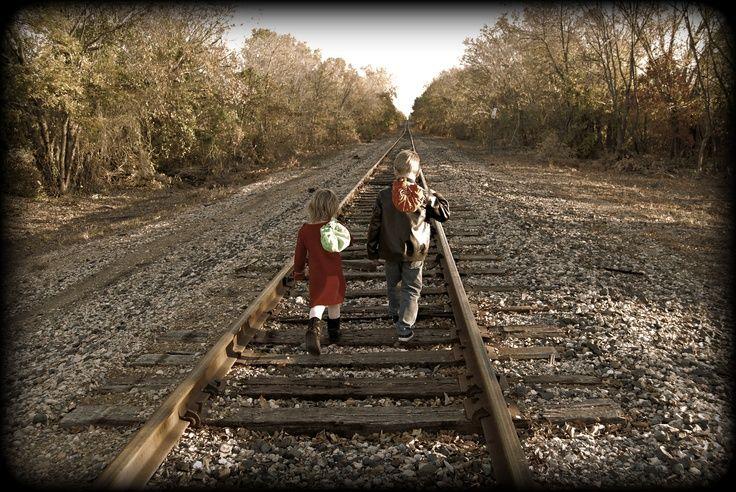train track poses for photo | Running away.....kids pose on train tracks | Sawyer's Birthday