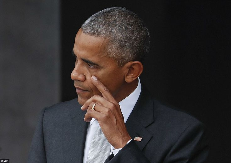 President Barack Obama wipes a tear from his cheek as he delivers a powerful and lengthy s...