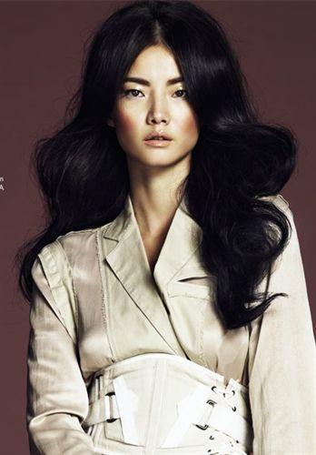 Jay Shin. Gorgeous Asian model.  Modern trench and Bond girl hair.