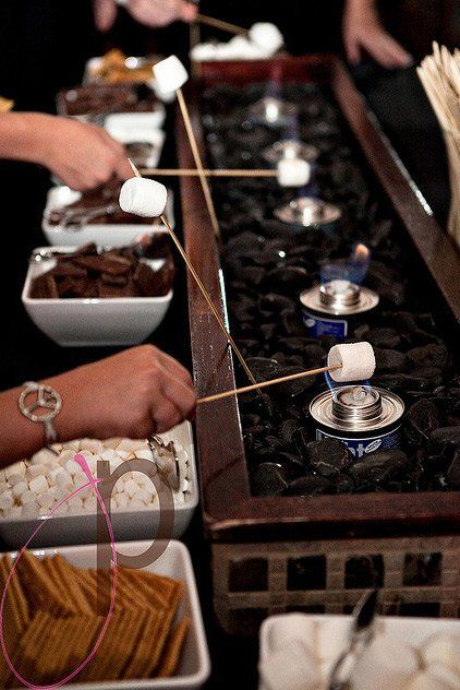 Party Idea: Sterno S'mores Buffet - Turning this idea into something that could be done at home wouldn't be too difficult, all you'd need to do is come up a few cans of sterno (or even just one if your party is small) and the accompanying S'mores accoutrement to go with it. It could be done on a patio, or small balcony without any issues and if you're daring — used inside.