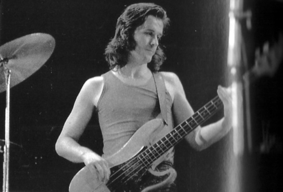 John Wetton 'the early days', played through a valve amp, great improviser. Listen to we'll let you know off starless and bible black. Try playing through valve amp - louder u get dirtier it sounds.
