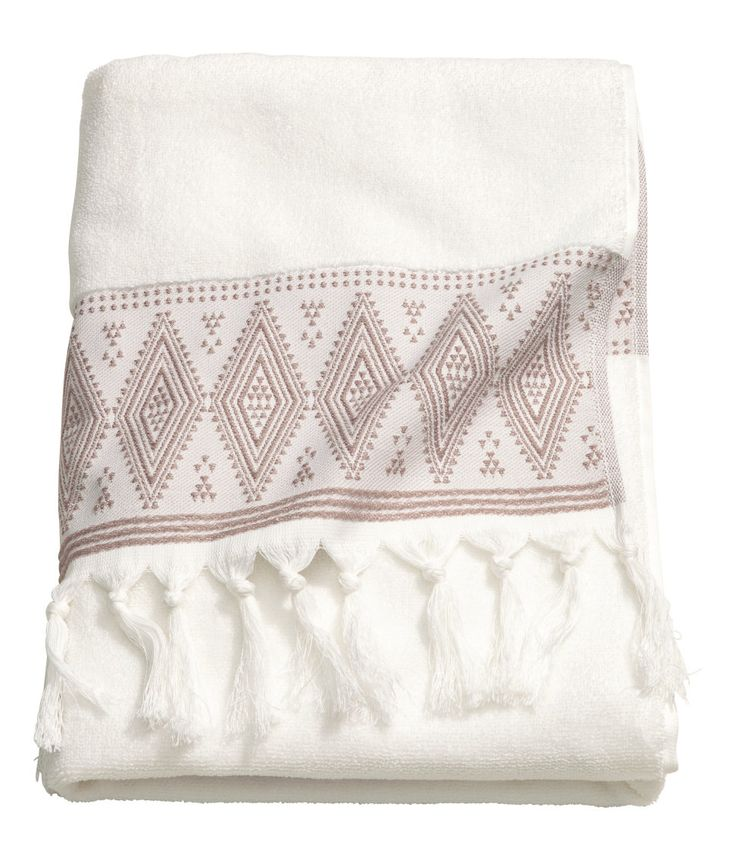 Check this out! Bath towel in soft cotton terry with an embroidered pattern and tassels on short sides. - Visit hm.com to see more.