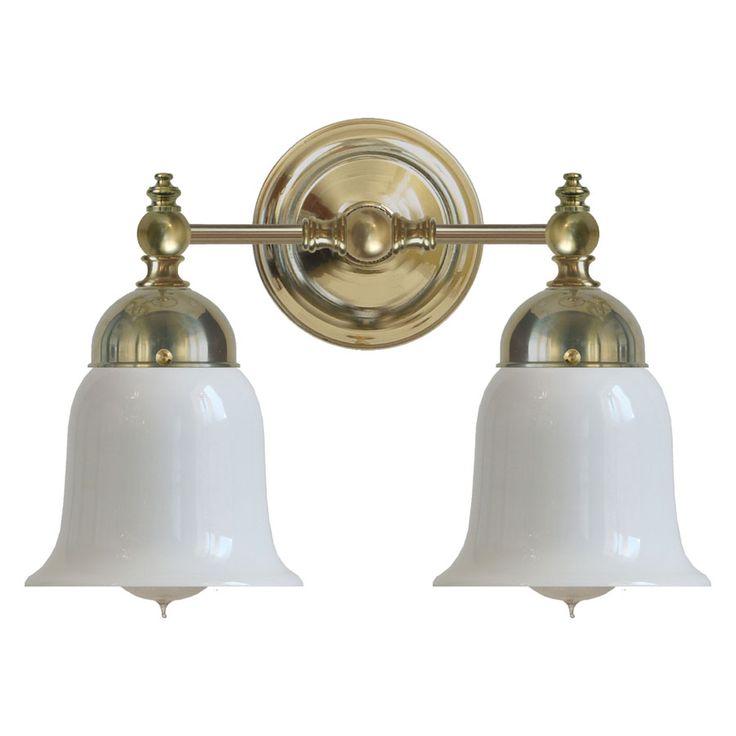 Badrumslampa Bergman mässing är en gammaldags vägglampa med klockskärmar i opalvitt glas. Välkommen in till Sekelskifte och våra klassiska vägglampor!
