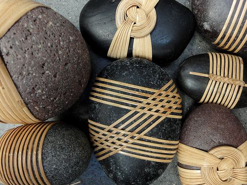 Tied Rocks by Shizu Okino. I saw these at the Asian Art Museum and loved  the idea of dressing up a simple natural element with ancient basket  weaving techniques. This could be applied in so many different ways, such  as wrapping a wedding bouquet or decorating a dinner table. What can you  think of? Let me know.