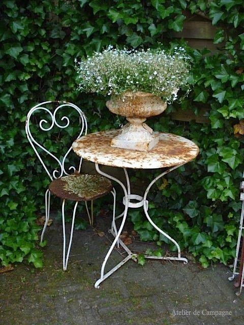 White Urn in the Garden by bettye