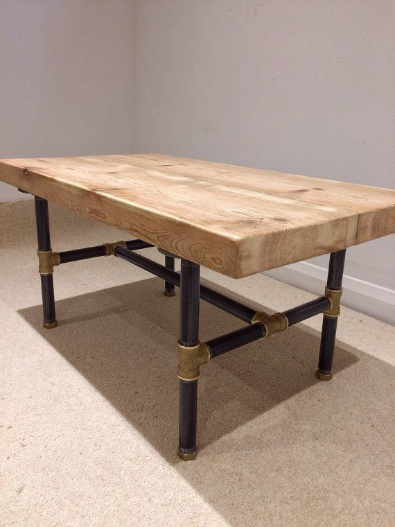 Reclaimed Victorian pine beam coffee table with black steel and brass pipe legs.  Length: 80cm Width: 45cm Height: 40cm  To keep costs down, the
