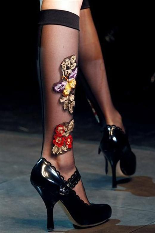 embroidered socks from Dolce & Gabbana's memorable A/W12 collection. There were numerous detailed socks in the 73-look collection but it was this pair, with their colour flower detailing,