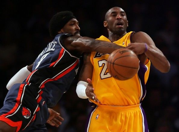 Gerald Wallace #3 of the Charlotte Bobcats knocks the ball away from Kobe Bryant #24 of the Los Angeles Lakers during the second quarter at Staples Center on March 26, 2008 in Los Angeles, California.