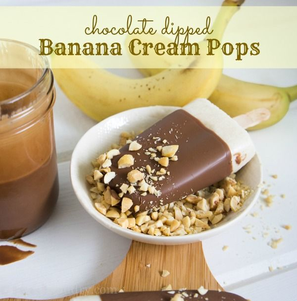 Chocolate Dipped Banana Cream Pops ~ so much better than just a regular old banana covered in chocolate and nuts. I blended bananas with cream, a little sugar and some vanilla to make an ultra creamy banana ice cream base. Then I used my simple 2 Ingredient Magic Shell to dip the banana cream pops in a thin layer of luscious chocolate.