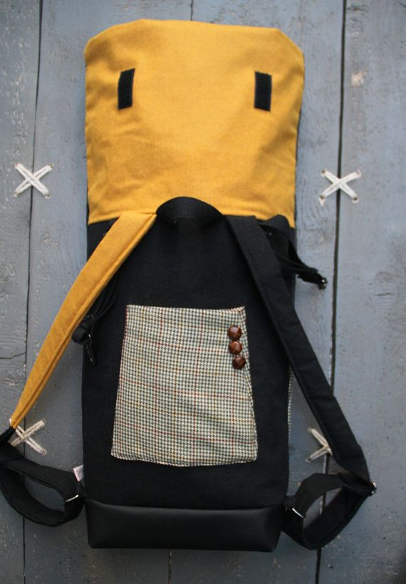 """Black, grey and ochre roll top rucksack with a sleeve from a men's suit as a pocket on the back, by """"EatingTheGoober"""""""