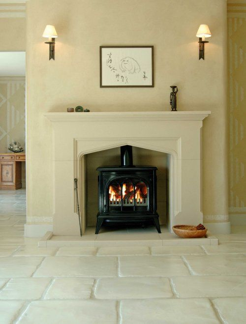 Pictures of old fireplace mantels used around cast iron stove cast stone fireplace brick - Brick fireplace surrounds ideas ...