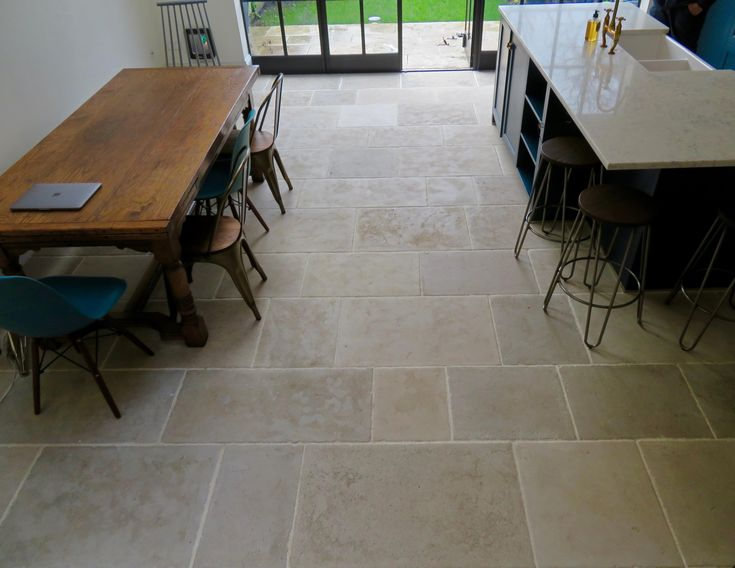 Paris Casa antiqued grey limestone tiles were used in this London kitchen which features kitchen cabinets painted in Farrow and Ball Hague Blue. http://www.naturalstoneconsulting.co.uk/antique-limestone-paris-casa-limestone-flooring