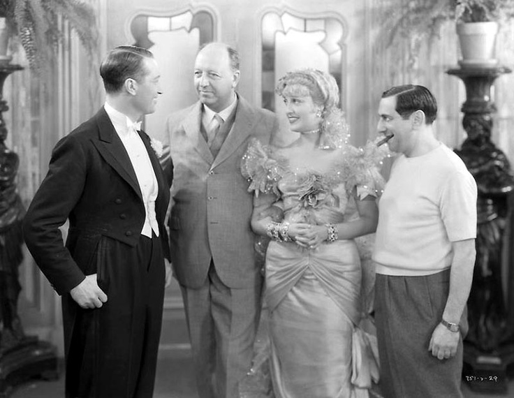 Baron Maurice de Rothschild (second from left) pays a visit to the set of The Merry Widow and is welcomed by Maurice Chevalier, Jeanette MacDonald and director Ernst Lubitsch. May, 1934